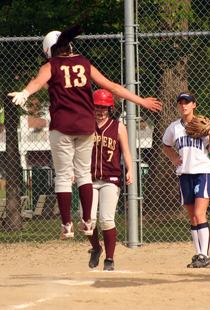 Newburyport: Cassaundra Davis (13) of Newburyport hops onto home plate following a triple which she streched into a inside the park home run on a throwing error during Monday's win over Wilmington. Photo by Ben Laing/Staff Photo