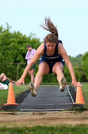 Byfield: Triton's Tori Clay attempts the long jump during Monday's track meet against Pentucket in Byfield. Photo by Ben Laing/Staff Photo