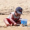 Newbury: Tidus Chhay, 3, of Lowell, spends the day playing in the sand at Plum Island with his mom and dad Tuesday morning. Photo by Ben Laing/Staff Photo