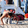 Newburyport: A swimmer coughs up water after being pulled from the waters at Plum Island point Tuesday afternoon. He was among seven rescued by private boaters before emergency personel arrived on scene. Photo by Ben Laing/Staff Photo
