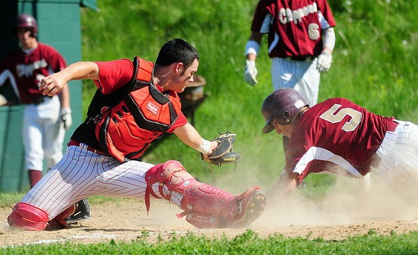 Amesbury: Newburyport's D.J. Grabowski (5) beats the tag of Amesbury catcher J.C. Collette (28) at home plate during Tuesday afternoon's game at Amesbury High School. Photo by Ben Laing/Staff Photo