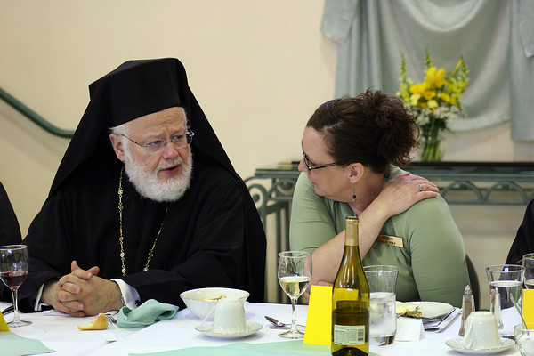 Newburyport: His Eminence Methodios speaks with Julie Ray during a luncheon at the Greek Orthodox Church in Newburyport Sunday afternoon. He was visiting the church in rememberance of the 25th anniversary of the fire that destroyed the original church on Harris Street. Photo by Ben Laing/Staff Photo