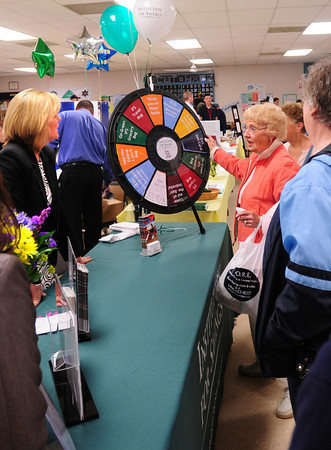 Salisbury: Cecil Nichols, right, of Newbury talks to Melissa LeBel of the Institution for Savings as she spins the wheel to win a prize. They were at the Health and Wellness Fair on Wednesday afternoon at the Hilton Center in Salisbury. Bryan Eaton/Staff Photo