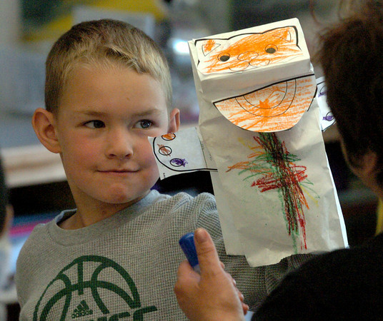"""Salisbury: Zachary Fowler, 5, shows off his cat hand puppet he made in Julie Deschene's prekindergarten class at Saliisbury Elementary School. The children did a unit on pets and read the book """"Cookie's Week"""" a story about a cat. Bryan Eaton/Staff Photo"""