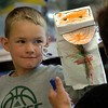 "Salisbury: Zachary Fowler, 5, shows off his cat hand puppet he made in Julie Deschene's prekindergarten class at Saliisbury Elementary School. The children did a unit on pets and read the book ""Cookie's Week"" a story about a cat. Bryan Eaton/Staff Photo"