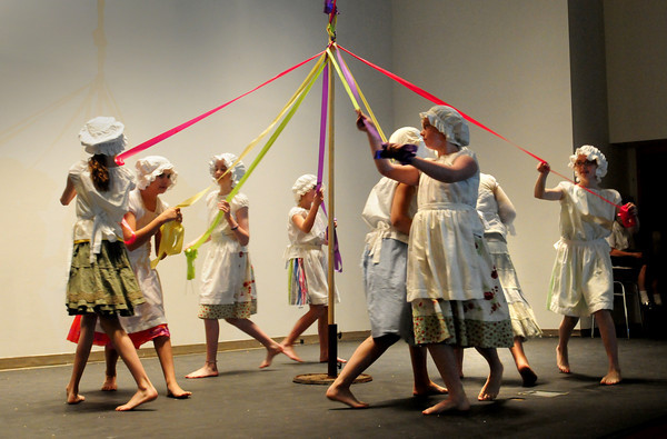 Newbury: Sixth-graders at Newbury Elementary School dance around the maypole during an assembly at the school Thursday morning. The school was putting on several programs to celebrate Newbury's 375th anniversary. Bryan Eaton/Staff Photo