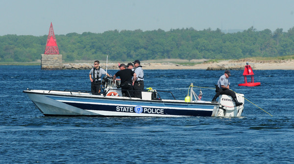 Newburyport: State police troll off Plum Island Point with a diver  attached to the line as they search for the body of Marina Khon. Bryan Eaton/Staff Photo