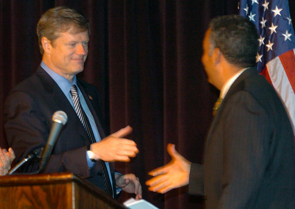 Salisbury: Massachusetts gubernatorial candidate Charlie Baker, left, congratulates Sheriff Frank Cousins on his receiving the Ed Molin Community Service Award at the Greater Newburyport Chamber of Commerce's Annual Luncheon yesterday at Ocean Blue Music Hall at Salisbury Beach. Bryan Eaton/Staff Photo