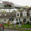 Newburyport: Newburyport firefighters quickly knocked down a fire in the attic at 5 Coombs Circle early yesterday afternoon. Bryan Eaton/Staff Photo