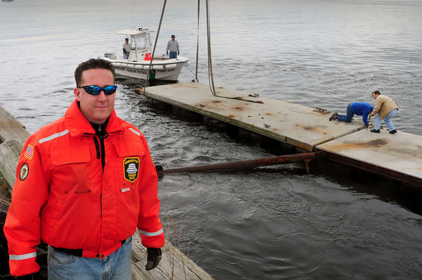 Newburyport: Paul Hogg, Newburyport's new harbormaster, was on hand yesterday as the docks were put into place on the waterfront. Bryan Eaton/Staff Photo