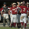 Newburyport: Newburyport's Kyle McElroy gets kudos from his teammates after a homerun against North Andover. Bryan Eaton/Staff Photo