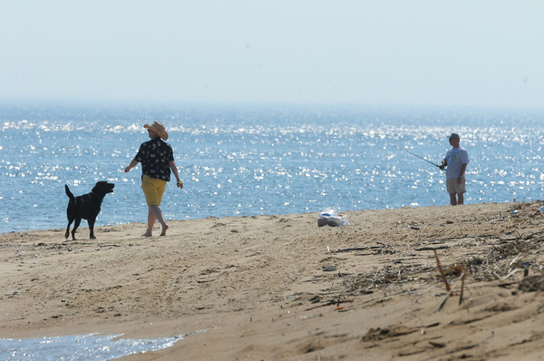 Newburyport: Yesterday was an ideal day for walking dogs or fishing on the beach as in this photo on Plum Island. The nice weather continues into the weekend, but not as hot. Bryan Eaton/Staff Photo