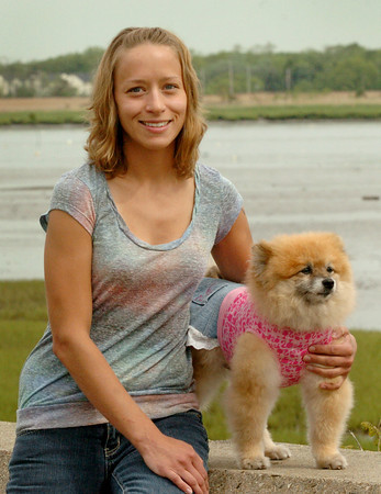 Newburyport:  Lisa Andrejczyk and her pomeranian, Dundie, who she dresses in costumes. The two have inspired the costume contest as psrt of this year's Strut for Strays, which talkes place Sunday in Newburyport to benefit the Merrimack River Feline Rescue Society. Bryan Eaton/Staff Photo