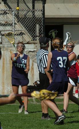Newburyport: Triton's #26 throws the ball to teammate Jen Rock. Bryan Eaton/Staff Photo