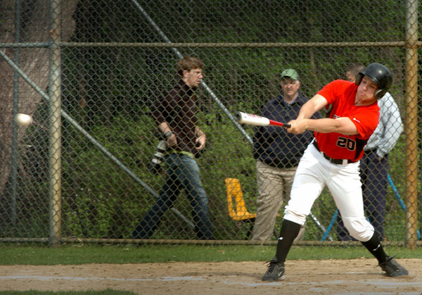Georgetown: North Andover's Mike Wersman swings for a single yesterday against Georgetown. Bryan Eaton/Staff Photo