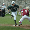 Newburyport: Pentucket's Josh Silva makes it past Newburyport baseman David Grabowski on a bunt as Newburyport pitcher Ryan O'Connor tried for the assist. Bryan Eaton/Staff Photo