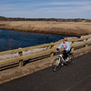 Salisbury: Mary Ann Fitzgerald rides past Town Creek on the Salisbury section of the Rail Trail. Bryan Eaton/Staff Photo
