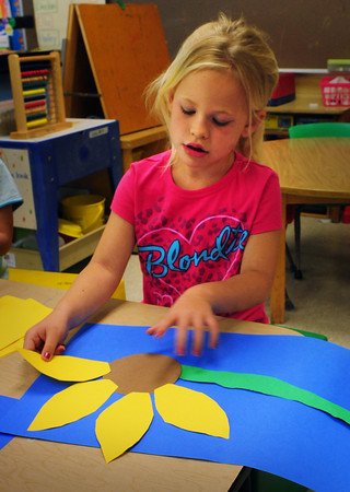 Amesbury: Ella Bezanson, 6, puts petals that she cut out to create a sunflower on Tuesday morning. She was in Marianne Curry's kindergarten class at Amesbury Elementary School.