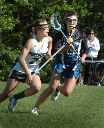 West Newbury: Pentucket's Kayla O'Connor moves the ball past Georgetown's #19 yesterday at Pipestave Hill. Bryan Eaton/Staff Photo
