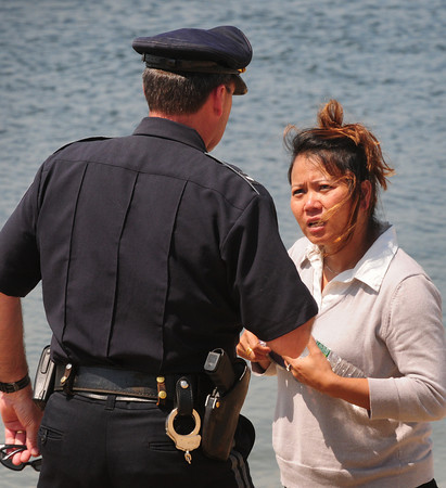 Newburyport: Newburyport Police Lt. Mark Murray, pictured, and Lt. Rich Siemasko tell the mother of Marina Khon who was swept away on a sandbar at Plum Island Point that the search for her body has been called off. Bryan Eaton/Staff Photo