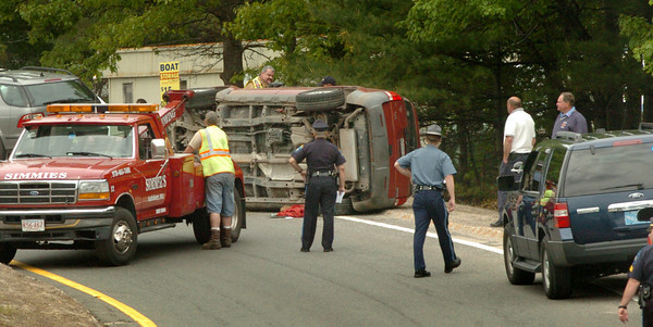 Amesbury: Rollover scene at onramp to Interstate 95 from Route 110. Bryan Eaton/Staff Photo
