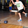 Amesbury: Michael Gadbois, 11, tries to knock down one last bowling pin at Leo's Superbowl in Amesbury on Thursday morning. Amesbury Middle School teachers of the East unit, treated to the bowling outing who achieved a degree of excellence in all of their classes. Bryan Eaton/Staff Photo