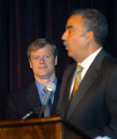 Salisbury: Massachusetts gubernatorial candidate Charlie Baker, left, listens as Sheriff Frank Cousins comments on his receiving the Ed Molin Community Service Award at the Greater Newburyport Chamber of Commerce's Annual Luncheon yesterday. Bryan Eaton/Staff Photo
