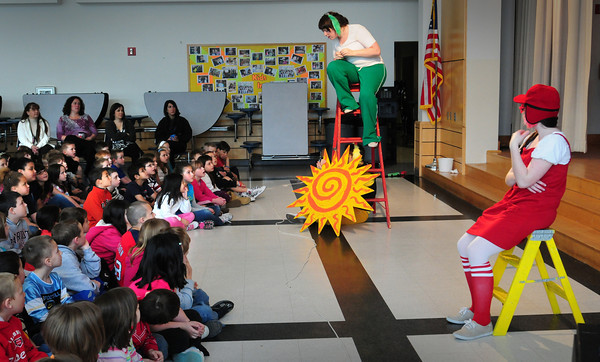 "Salisbury: First and second-graders watch student performers of the Stoneham Theater put on the play ""Go Dog. Go!"" on Monday morning. ""Go, Dog. Go!"" is a physical comedy with music and clowning, adapted from the books by P.D. Eastman and was sponsored by the school's PTA. Bryan Eaton/Staff Photo"