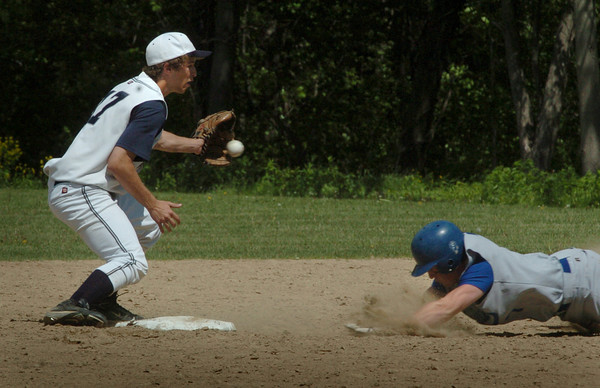 Georgetown: Georgetown's Chris Esposito eats some dirt safely stealing second base past Hamilton-Wenhan shortstop Jared Kefalas. Bryan Eaton/Staff Photo