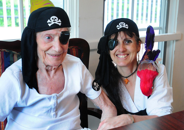 "Newburyport: Brigham Manor in Newburyport celebrated Nursing Home Week by taking a different ""trip"" each day of the week. Yesterday staff and residents dressed up as pirates for the high seas theme with resident Barbara Perkins, left, and aide Teresa Whittlesey wearing their eye patches. Bryan Eaton/Staff Photo"