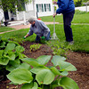 Amesbury: Members of the Whittier Home garden committee spruced up around the famous poet's home in Amesbury including Pat Grenier, left, and Sue Curry, chairman of the group. The area behind the home is used for various events, including several high teas throughout the summer. Bryan Eaton/Staff Photo