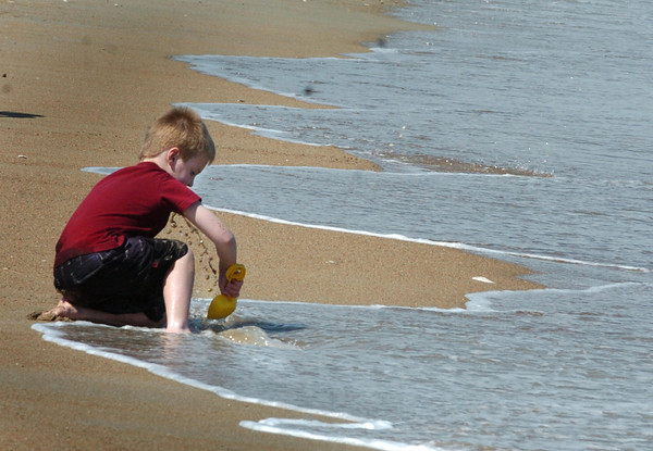 Salisbury: Just as fast as Nathan Schimming, 7, of Amesbury was trying to build a sandcastle at Salisbury Beach, the waves would thwart his attempts. The youngster was there with some friends as school in Amesbury let out early on Wednesday. Bryan Eaton/Staff Photo
