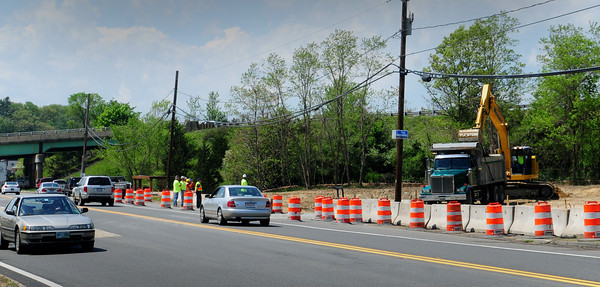 Amesbury: Workers construct a retention area on Route 110 at Interstate 495 in anticipation of the widening of the busy road. Bryan Eaton/Staff Photo