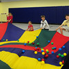 Amesbury: Students in Melissa York's gym class at Amesbury Elementary School played different games using a parachute on Monday morning. Here they were pulling faster and faster to shoot the balls up into the air. Bryan Eaton/Staff Photo
