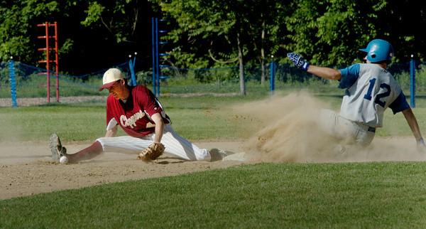 Georgetown: Georgetown's Ryan Browner steals second base as the ball gets past Newburyport second baseman Ben Tyler. Bryan Eaton/Staff Photo