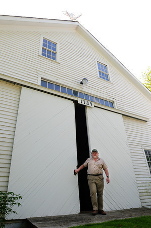 Newburyport: Dick Chase at the barn of the farmhouse he wants to renovate through Community Preservation Act. Bryan Eaton/Staff Photo