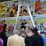 Amesbury:  Artist Jon Mooers talks to people in front of his cartoon-mural of Al Capp's biography just before a small ceremony Saturday at the Hamilton Gateway entrance to Amesbury's Upper M ...