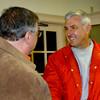 Newbury: Chuck Bear, right, gets congratulated by fellow candidate Frank Chiaravallotti after winning the Newbury selectman seat last night. Bryan Eaton/Staff Photo