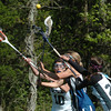 West Newbury: Pentucket's Liz Jayne passes to teammate Steph Fitzgerald in action against Georgetown yesterday afternoon. Bryan Eaton/Staff Photo