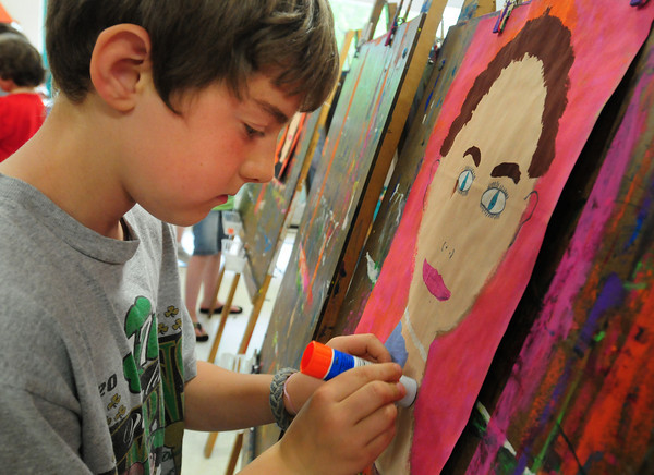 Newburyport: Miles O'Malley, 8, works on a portrait of his mother, Robin, who is a teacher at the Brown School in Newburyport. The students in Pam Jamison's third grade art classes were making the portraits for Mother's Day which is Sunday. Bryan Eaton/Staff Photo