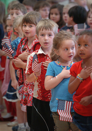 Newburyport: Students at the Brown School recite the Pledge of Allegiance under direction of Bill Plante who was the guest speaker at the school's Memorial Day Remembrance on Friday morning. Plante, who was at the Battle of the Bulge in World War II, spoke about the importance of the flag stands for. Bryan Eaton/Staff Photo
