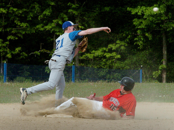 Georgetown: Georgetown's Adam Johnson tries for a double play as he gets North Andovers Connor Walsh out at second. Bryan Eaton/Staff Photo