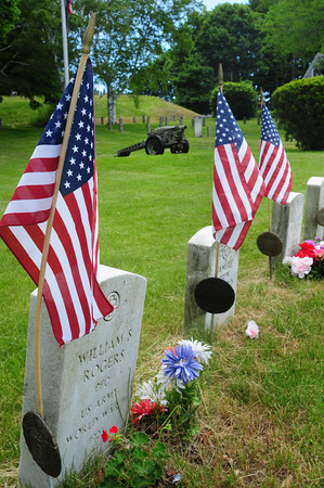 Newburyport: New flags are draped at  the Veteran's Cemetery on Pond Street in Newburyport. Bryan Eaton/Staff Photo