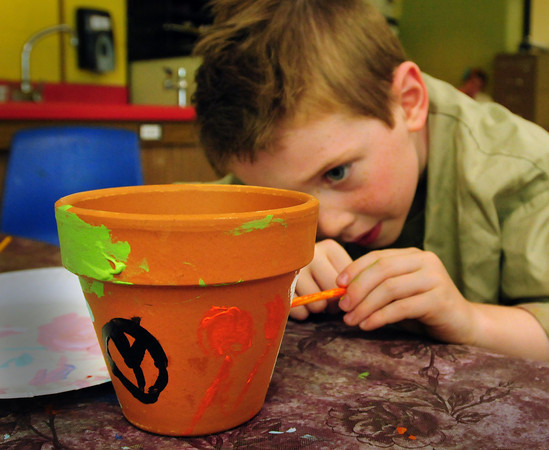 Amesbury: Colby Picard, 6, decorates a flower pot in Becky Reese's kindergarten class at Amesbury Elementary School on Thursday morning. The children planted sunflowers in paper cups and will transplant them to the pot when they get bigger. Bryan Eaton/Staff Photo