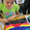 Amesbury: Students in Karen Greenfield's art class at Amesbury Elementary School were drawing impressionast-style paintings of a special memory. Kyra Tripp, 9, drew a sunset that she saw on Mt. Desert Island on a trip there with her family. Bryan Eaton/Staff Photo