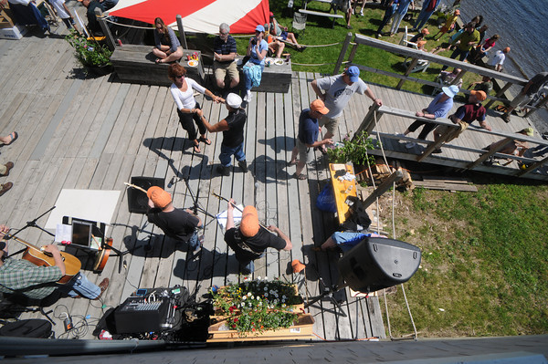 Amesbury: The band Demijon Music Clan performs at The Mighty Merrimack Rowing Race at Lowell's Boat Shop in Amesbury Sunday afternoon. Jim Vaiknoras/Staff photo