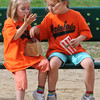 Rowley: Twins Amy and Rachel Southall, 5,  share popcorn  on the newly rededicated Eriar Park in Rowley Saturday.Rowley: The new playground  has been installed and a dedication ceremony took place on Saturday.  New park signs and a memorial stone in memory of Stephanie Jenkins, a long-time Rowley resident who lost her battle with renal cancer in November 2009 and whose fundraising events in her memory have paid for the park updates, were unvieled. Jim Vaiknoras/Staff photo