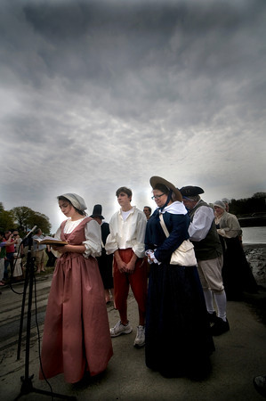 Newbury: Abby Matses, Richie Aversa, Bonnie Jean Wilbur and Paul Wann lead a group of reinactors in a hymn of the banks of the Parker River Saturday during the towns 375th celebration. The group came up the river in row boats landing near the spot the first settler landed in 1635. jim Vaiknoras/Staff photo