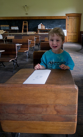 Newbury: Eben Dooling, 3, of Byfield got a taste of colonial education while visiting the Lower Green School House during the Newbury 375 celebration Saturday. Jim Vaiknoras/Staff photo