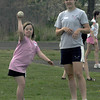 Newburyport: Amanda Kelleher tosses a softball with Erin Curley. during the Clipper jr practice  at Fuller field in Newburyport. The program has high school track athletes work special needs athlete on track and field skills. Jim vaiknoras/Staff photo